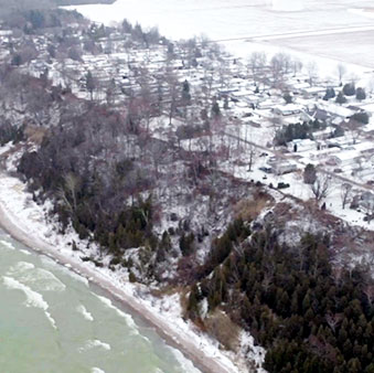 An aerial drone photo showing the eroding bluffs at Meneset on the Lake in Goderich Ontario, Canada.